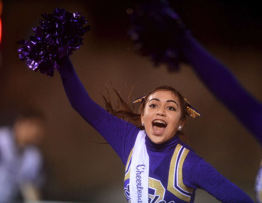 A Brackenridge cheerleader preforms during a high school football game between Brackenridge and Jefferson at Alamo Stadium in San Antonio, Friday, September 28, 2012.