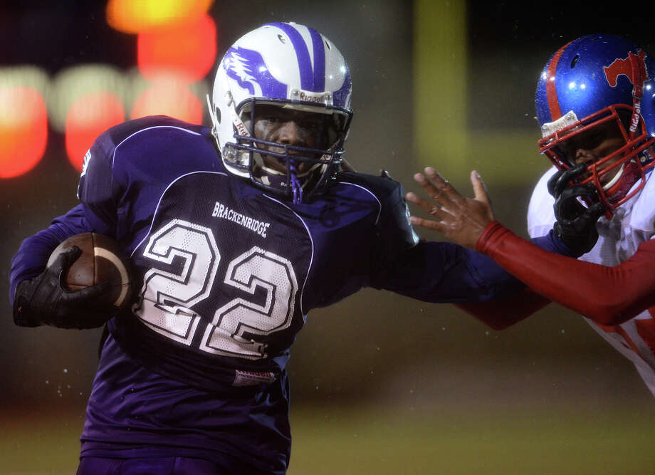 Brackenridge's Trey Mathis (22) stiff-arms a Jefferson defender during a high school football game between Brackenridge and Jefferson at Alamo Stadium in San Antonio, Friday, September 28, 2012.
