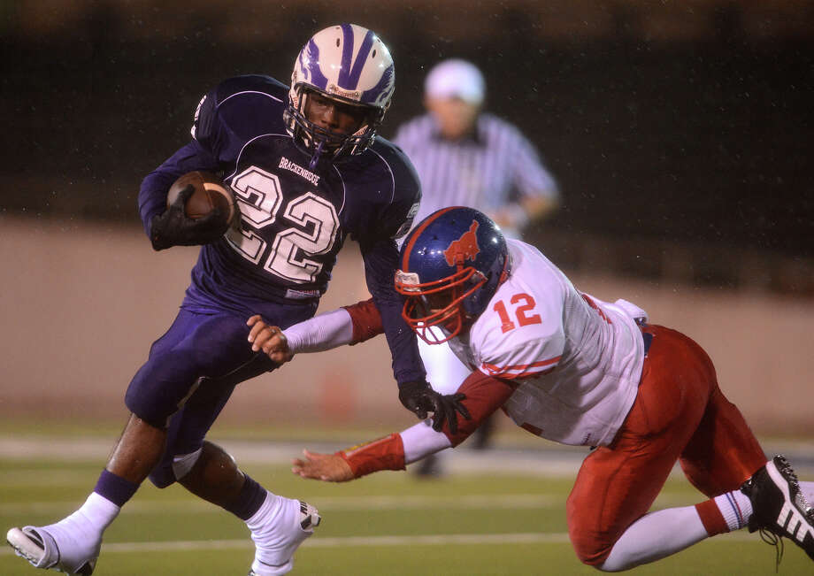 Brackenridge's Trey Mathis (22) tries to get around Jefferson's Nathan DeHoyos (12) during a high school football game between Brackenridge and Jefferson at Alamo Stadium in San Antonio, Friday, September 28, 2012.