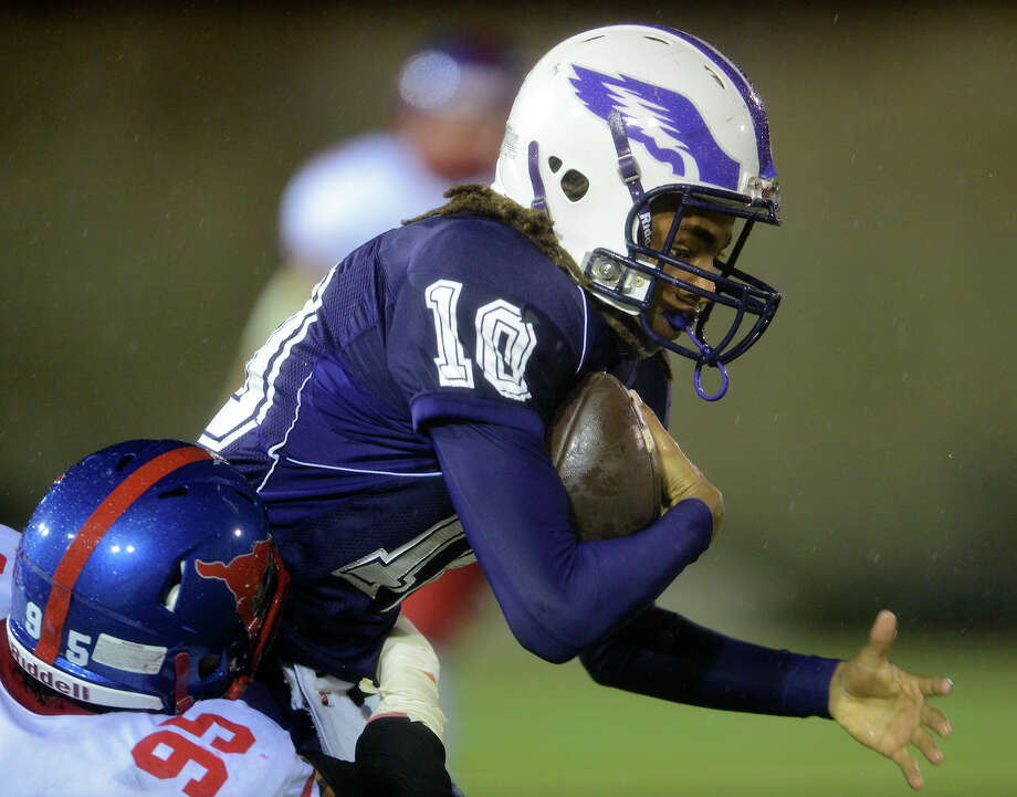 Brackenridge's Ramo Richards (10) is tackled by Jefferson's Troy Mendez (95) during a high school football game between Brackenridge and Jefferson at Alamo Stadium in San Antonio, Friday, September 28, 2012. John Albright / Special to the Express-News. Photo: JOHN ALBRIGHT, Express-News / San Antonio Express-News