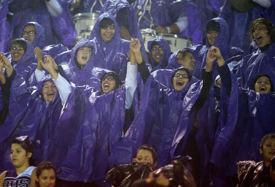 Members of the Brackenridge Band cheer during a high school football game between Brackenridge and Jefferson at Alamo Stadium in San Antonio, Friday, September 28, 2012.