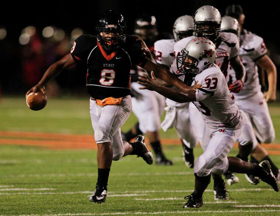 Texas City quarterback Andrew Allen #8 fends off Goose Creek's  Sedan Dre Alexander #33 as he rushes during  a district 24-4A high school football game September 28, 2012 in Texas City. (Bob Levey/For The Chronicle) Photo: Bob Levey, Houston Chronicle / ©2012 Bob Levey