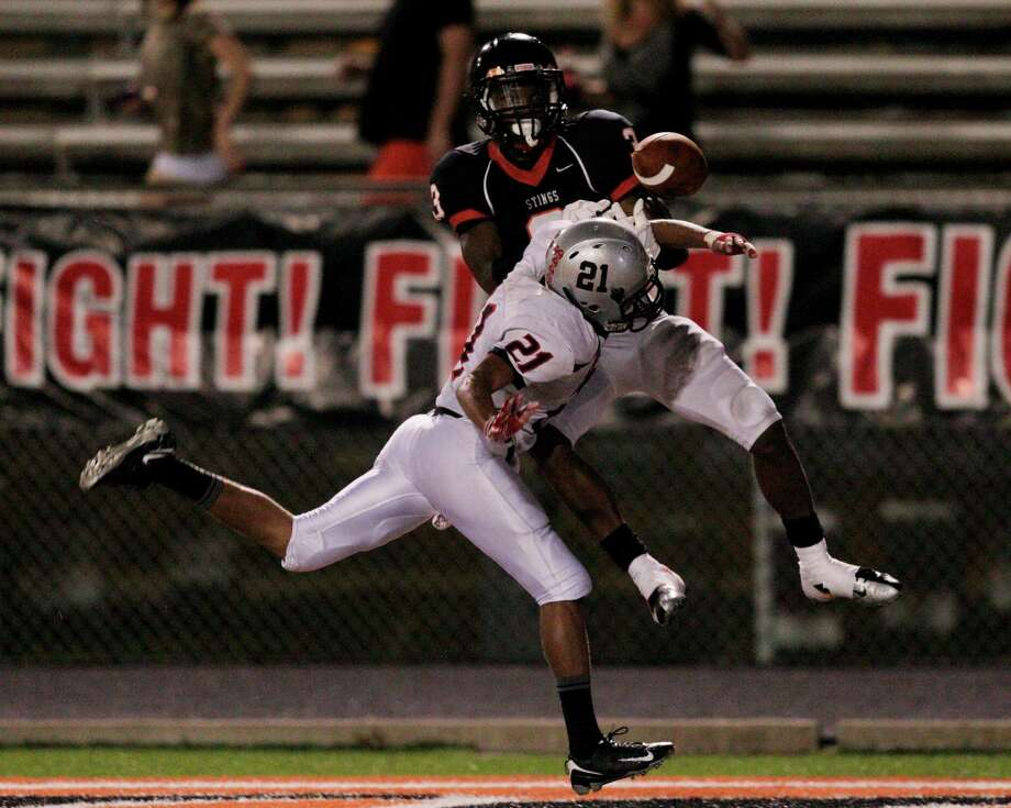 Texas City 49, Goose Creek Memorial 32Texas City wide receiver Armanti Foreman #3 has the ball knocked loose by the Goose Creek secondary during  a district 24-4A high school football game September 28, 2012 in Texas City. (Bob Levey/For The Chronicle) Photo: Bob Levey, Houston Chronicle / ©2012 Bob Levey
