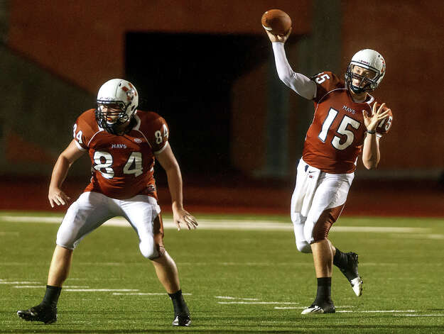 Madison quarterback Cody Ennis gets off a pass as Kyle Hime provides protection during their game with Churchill at Heroes Stadium on Sept. 28, 2012.  Madison won the game 49-14.  MARVIN PFEIFFER/ mpfeiffer@express-news.net Photo: MARVIN PFEIFFER, Express-News / Express-News 2012