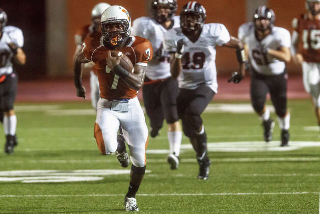 Madison running back Marquis Warford takes off on an 85-yard touchdown during the first quarter of the Mavericks' game with Churchill at Heroes Stadium on Sept. 28, 2012.  Warford ran for 358 yards on 12 carries and scored four touchdowns to help Madison beat the Chargers 49-14.  MARVIN PFEIFFER/ mpfeiffer@express-news.net Photo: MARVIN PFEIFFER, Express-News / Express-News 2012