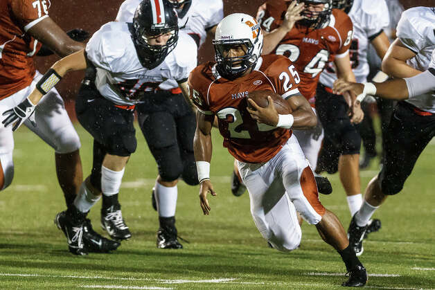 Madison running back Galen McAllister (25) breaks through the Churchill line for a nice gain during their game at Heroes Stadium on Sept. 28, 2012.  Madison won the game 49-14.  MARVIN PFEIFFER/ mpfeiffer@express-news.net Photo: MARVIN PFEIFFER, Express-News / Express-News 2012