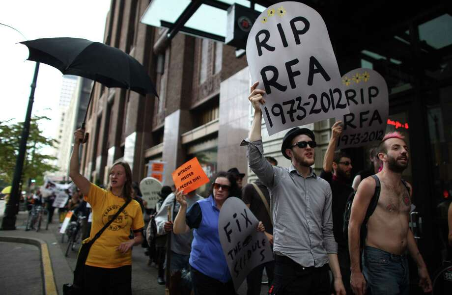 """Protesters march during a """"funeral"""" for downtown Seattle's free ride area last Friday. Photo: JOSHUA TRUJILLO / SEATTLEPI.COM"""