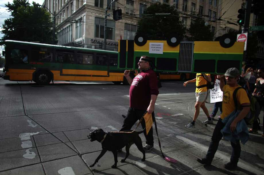 "People carry a cardboard bus during a ""funeral"" for downtown Seattle's free ride area. Photo: JOSHUA TRUJILLO / SEATTLEPI.COM"