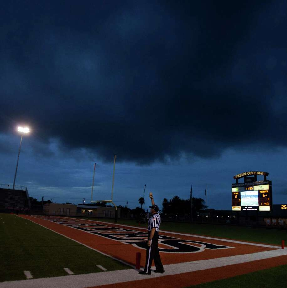 Ominous clouds linger before the start of the District 24-4A matchup between Goose Creek and Texas City on Friday in Texas City. Photo: Bob Levey / ©2012 Bob Levey
