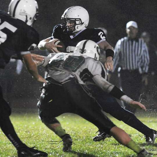 Rensselaer QB #2 Steven Harwood scrambles for a gain during Friday night's game against Greenwich in