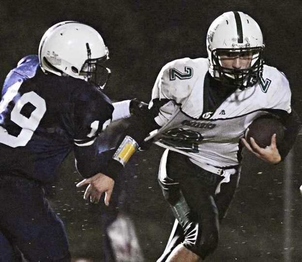 Greenwich's #2 Jeremy Messina struggles to get away from  Rensselaer's #19 Brandon Butler during Fri