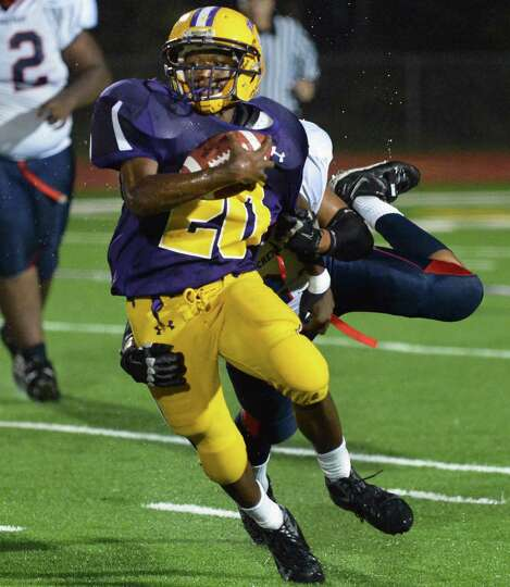 Troy's #20 Maurice Jones breaks away from a Schenectady tackle during Friday night's game at Troy Hi