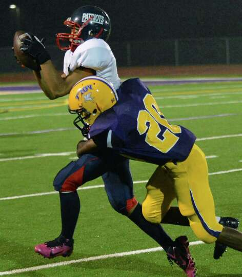 Schenectady #9 Alex Phann catches a pass from QB Kwame Jarvis as Troys #20 Maurice Jones defends dur