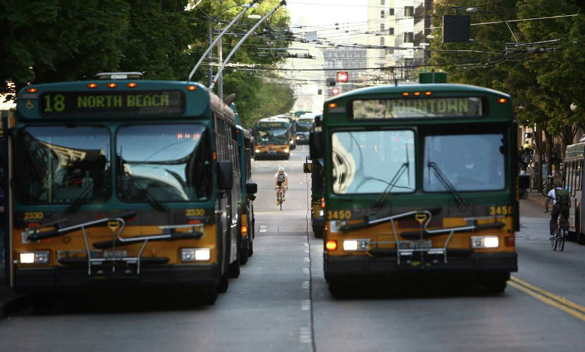 Buses travel down 3rd Avenue in downtown Seattle.  As of late September, buses and bicyclists will reign supreme on the busy street.  Private vehicles will be banned 6 a.m. to 7 p.m., seven days a week.