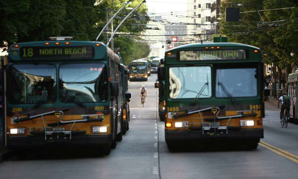 Buses travel down 3rd Avenue in downtown Seattle's free ride area. The free service has been in plac
