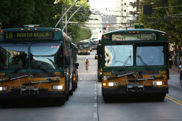 Buses travel down 3rd Avenue in downtown Seattle's free ride area. On September 29th King County Metro's free ride area will end, along with many other service changes. Advocates say the end of the free rides will impact the poor and elderly that use the service. The Friday afternoon protest was organized by the Transit Riders Union. Photographed on Friday, September 28, 2012 in downtown Seattle.