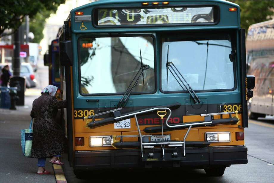 A woman boards a bus in downtown Seattle's free ride area. On September 29th King County Metro's free ride area will end, along with many other service changes. Advocates say the end of the free rides will impact the poor and elderly that use the service. The Friday afternoon protest was organized by the Transit Riders Union. Photo: JOSHUA TRUJILLO / SEATTLEPI.COM