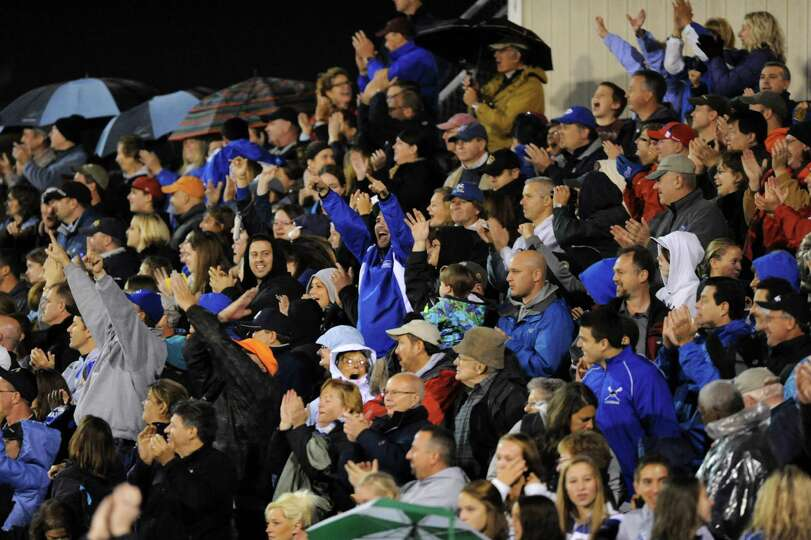 Shaker fans cheer for their team during their football game against Shenendehowa on Friday, Sept. 28