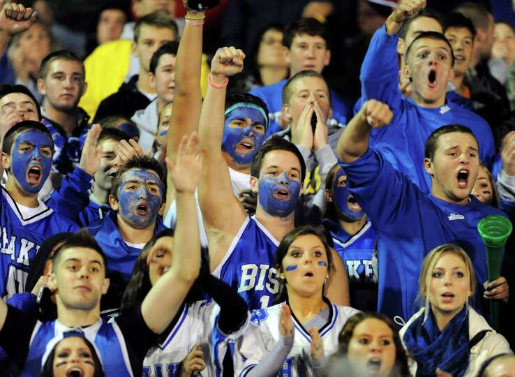 Shaker's student section cheer for their team during their football game against Shenendehowa on Fri