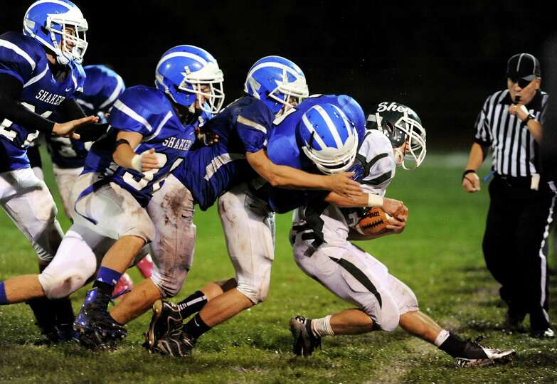 Shenendehowa's Corey Acker (22), right, gets runs out of bounds by a host of Shaker defensement duri
