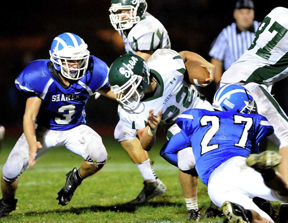 Shaker's Enrico Battibulli (3), left, and Slex Bazanos (27), right, stop Shenendehowa's Corey Acker (22) from getting in the end zone during their football game on Friday, Sept. 28, 2012, at Shaker High in Latham, N.Y. Shaker wins 35-0. (Cindy Schultz / Times Union) Photo: Cindy Schultz / 00019405A