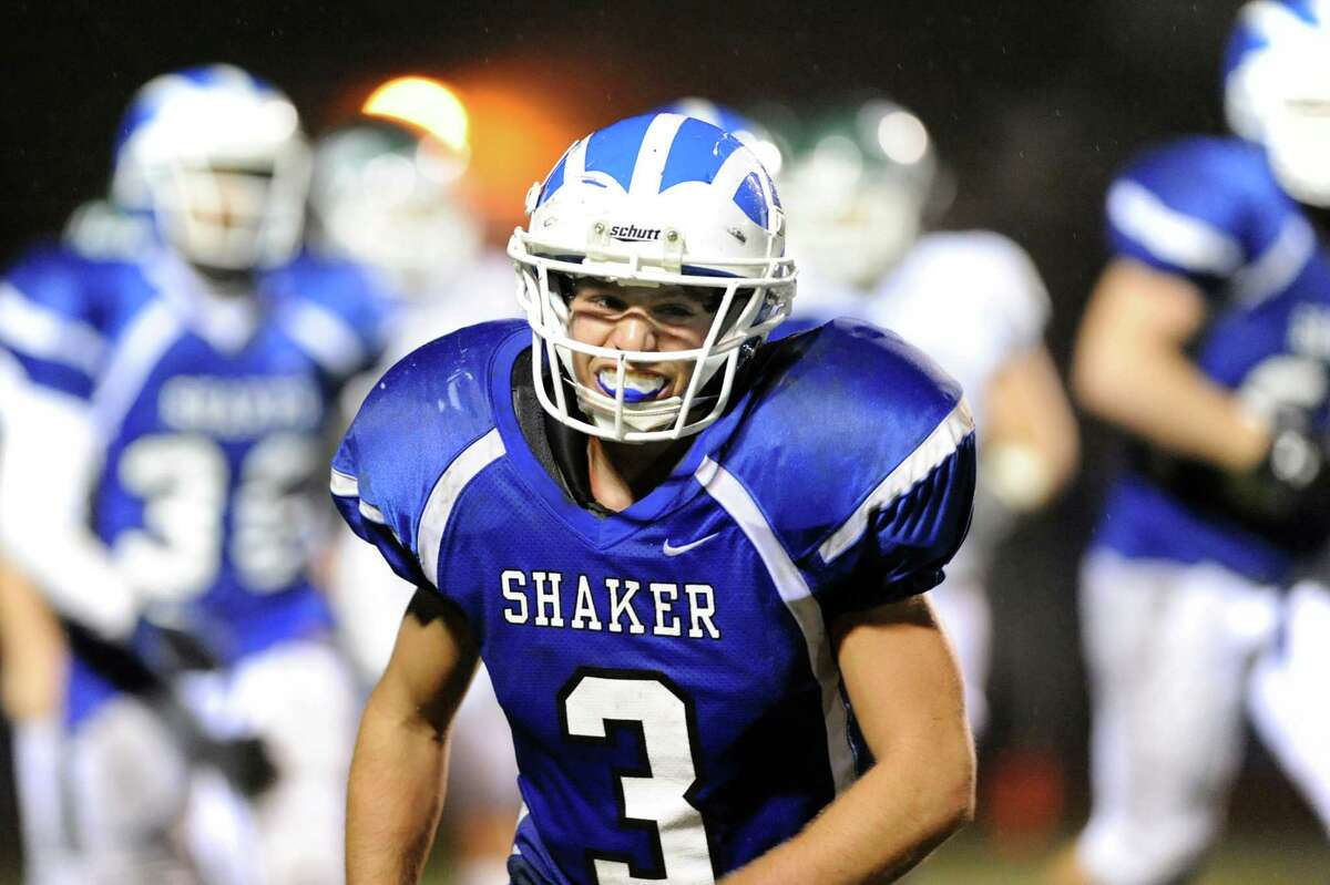 Shaker's Enrico Battibulli (3), center, grins after he helps stop a Shenendehowa touchdown during their football game on Friday, Sept. 28, 2012, at Shaker High in Latham, N.Y. (Cindy Schultz / Times Union)