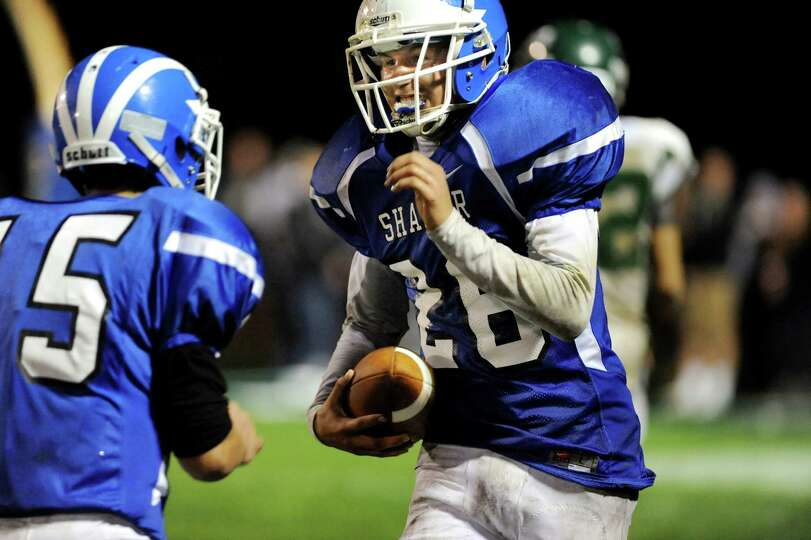 Shaker's Sean Egan (26), right, celebrates a touchdown with teammate Russell Bird (15) during their