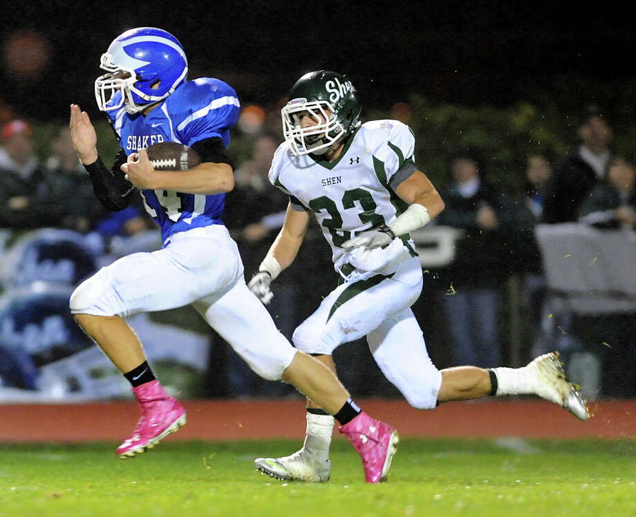 Shaker's Tyler Oppelt (14), left, outruns Shenendehowa's Kyle Buss (23) to score a touchdown during their football game on Friday, Sept. 28, 2012, at Shaker High in Latham, N.Y. (Cindy Schultz / Times Union) Photo: Cindy Schultz / 00019405A
