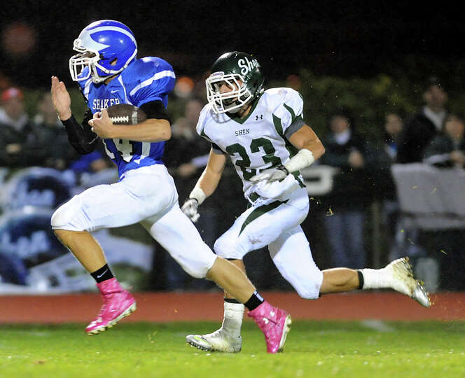 Shaker's Tyler Oppelt (14), left, outruns Shenendehowa's Kyle Buss (23) to score a touchdown during