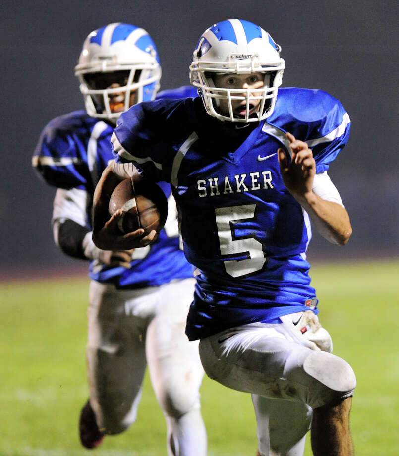 Shaker's quarterback Chris Landers (5), right, runs into the end zone untouched to score a touchdown during their football game against Shenendehowa on Friday, Sept. 28, 2012, at Shaker High in Latham, N.Y. (Cindy Schultz / Times Union) Photo: Cindy Schultz / 00019405A