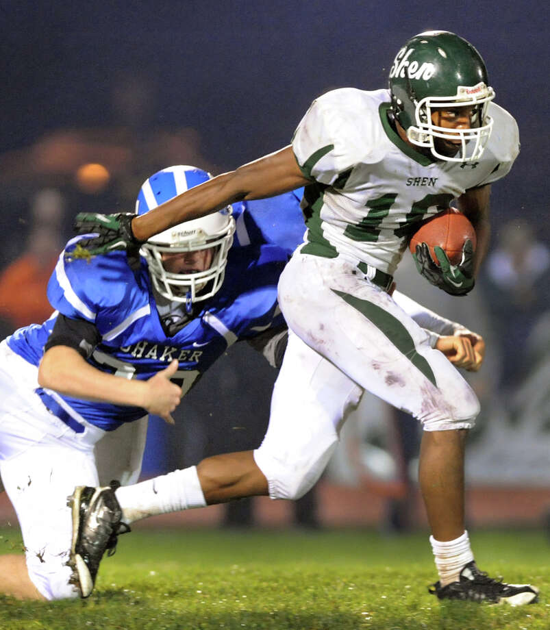 Shenendehowa's Anthony Lee (10), right, gets past Shaker's Justin Safford (30) during their football game on Friday, Sept. 28, 2012, at Shaker High in Latham, N.Y. (Cindy Schultz / Times Union) Photo: Cindy Schultz / 00019405A