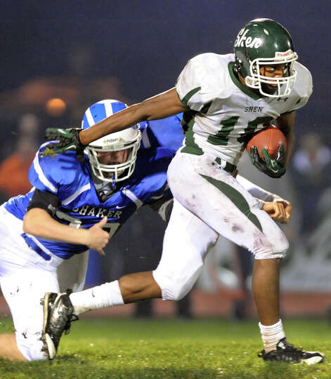 Shenendehowa's Anthony Lee (10), right, gets past Shaker's Justin Safford (30) during their football