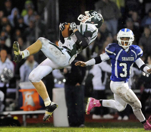 Shenendehowa's Eric Hurd (87), left, catches a pass as Shaker's Kenny Jackson (34) defends during th