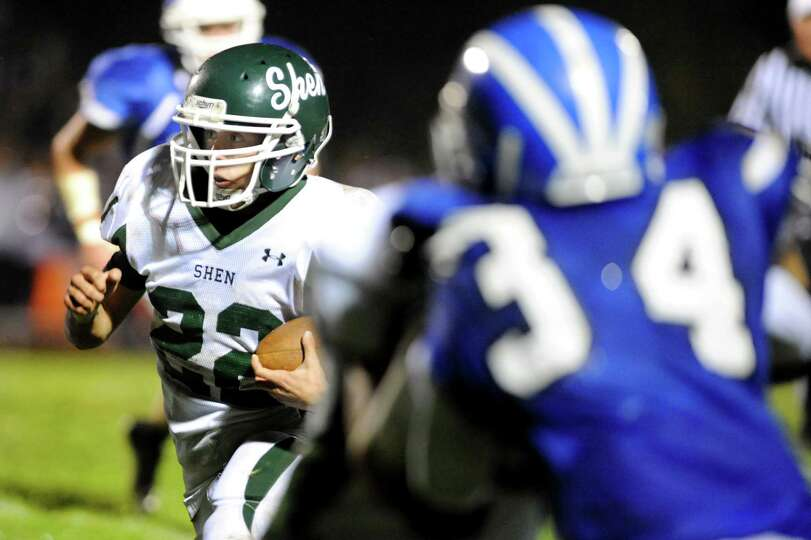 Shenendehowa's Corey Acker (22), left, gains yards during their football game against Shaker on Frid