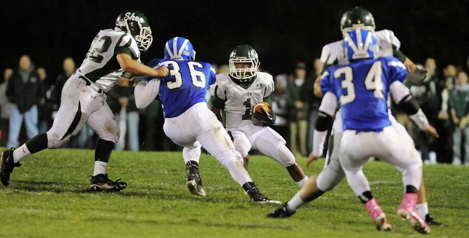 Shenendehowa's Marcelino Christie (1), center, runs the ball during their football game against Shaker on Friday, Sept. 28, 2012, at Shaker High in Latham, N.Y. (Cindy Schultz / Times Union) Photo: Cindy Schultz / 00019405A
