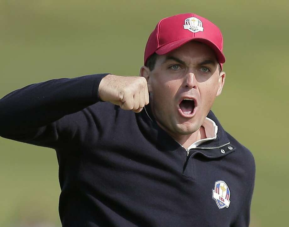 USA's Keegan Bradley celebrates after winning their foursomes match on the 15th hole at the Ryder Cup PGA golf tournament Friday, Sept. 28, 2012, at the Medinah Country Club in Medinah, Ill. (AP Photo/Charlie Riedel) Photo: Charlie Riedel, Associated Press