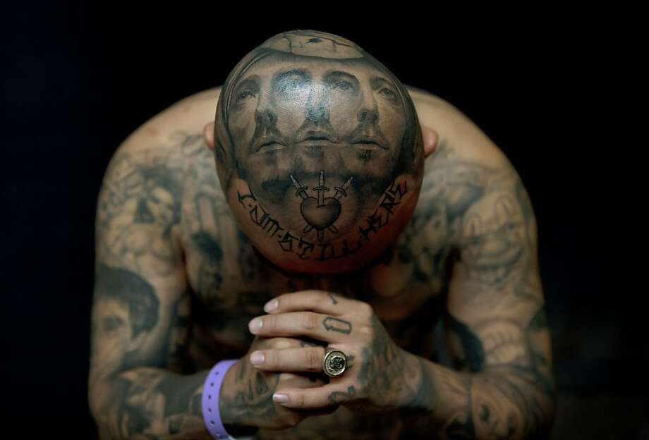 """""""Oldies"""" poses for a photograph to display his tattoos by artist Josh Lin during the 8th International London Tattoo convention at Tobacco Dock east London on September 28, 2012.  World famous tattoo artists gathered in London for the annual event. Photo: Adrian Dennis, AFP/Getty Images"""