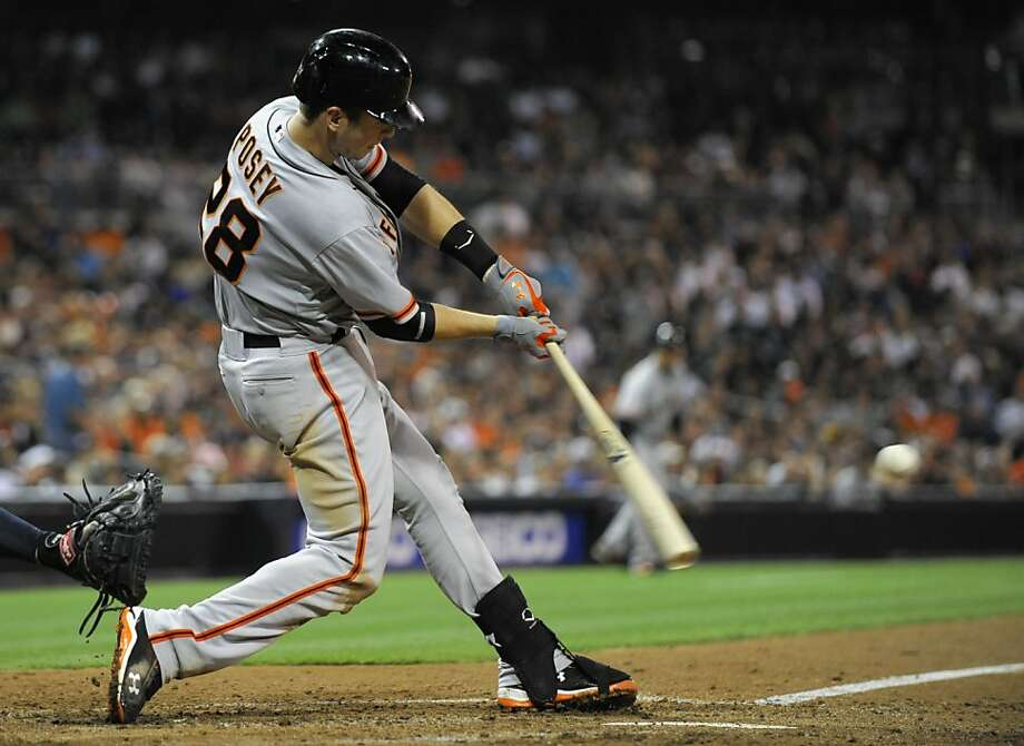 SAN DIEGO, CA - SEPTEMBER 28: Buster Posey #28 of the San Francisco Giants hits a double during the fifth inning of a baseball game against the San Diego Padres at Petco Park on September 28, 2012 in San Diego, California. (Photo by Denis Poroy/Getty Images) Photo: Denis Poroy, Getty Images