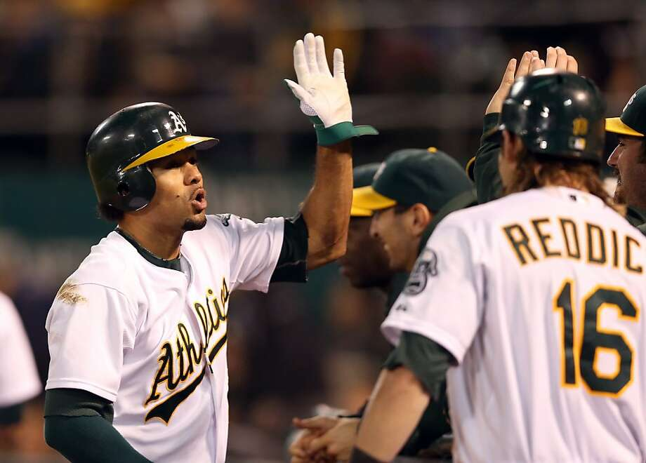 OAKLAND, CA - SEPTEMBER 28:  Coco Crisp #4 of the Oakland Athletics is congratulated by teammates after he hit a lead off home run against the Seattle Mariners at O.co Coliseum on September 28, 2012 in Oakland, California.  (Photo by Ezra Shaw/Getty Images) Photo: Ezra Shaw, Getty Images