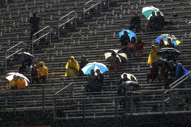 Churchill fans brave the rainy conditions to watch the Chargers play Madison at Heroes Stadium on Sept. 28, 2012.  MARVIN PFEIFFER/ mpfeiffer@express-news.net Photo: MARVIN PFEIFFER, Express-News / Express-News 2012