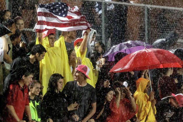 Churchill fans brave the rain during the second half of their game with Madison at Heroes Stadium on Sept. 28, 2012.  MARVIN PFEIFFER/ mpfeiffer@express-news.net Photo: MARVIN PFEIFFER, Express-News / Express-News 2012
