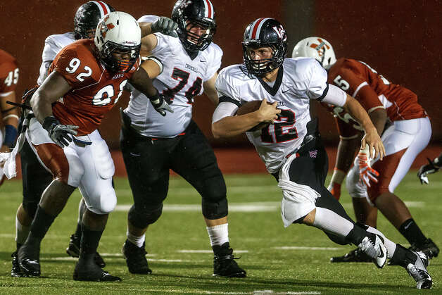 Churchill quarterback Nate Pearson (right) picks up yardage on a running play during their game with Madison at Heroes Stadium on Sept. 28, 2012.  MARVIN PFEIFFER/ mpfeiffer@express-news.net Photo: MARVIN PFEIFFER, Express-News / Express-News 2012