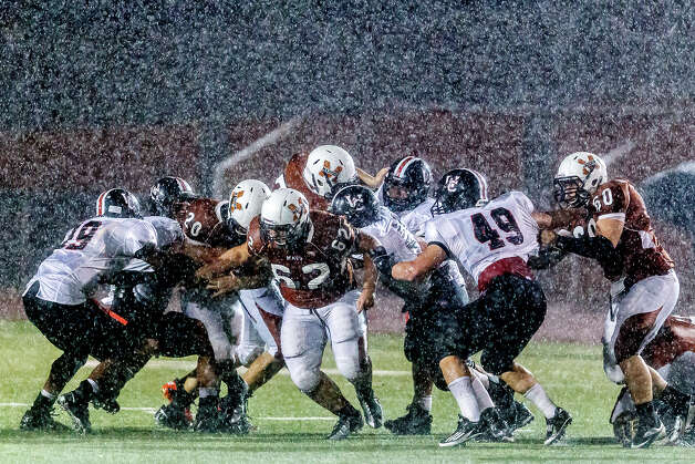 Heavy rain falls near the end of the Churchill - Madison game at Heroes Stadium on Sept. 28, 2012.  The game was called with four minutes remaining for lightning with Madison ahead 49-14.  MARVIN PFEIFFER/ mpfeiffer@express-news.net Photo: MARVIN PFEIFFER, Express-News / Express-News 2012