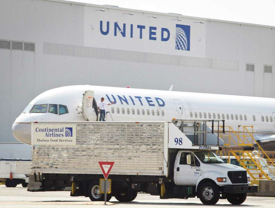 A Chelsea Food Services truck carries the old Continental Airlines logo last week at Bush Intercontinental Airport.  Monday marks two years since the United- Continental merger closed. Photo: Nick De La Torre / © 2012 Houston Chronicle