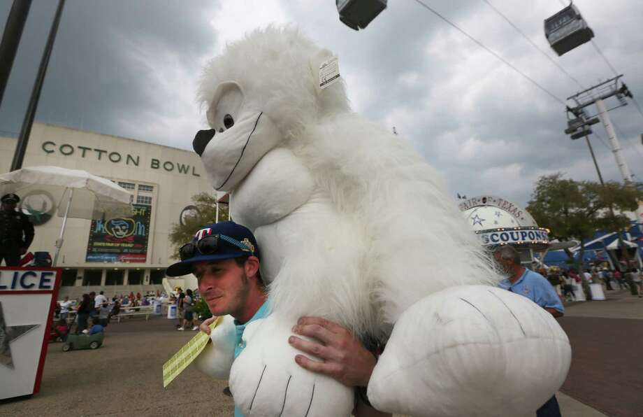Kenneth Whittington, of Carrolton, Texas, carries a stuffed animal he won during the State Fair of Texas, Friday, Sept. 28, 2012, in Dallas.   (AP Photo/LM Otero) Photo: LM Otero, Associated Press / AP