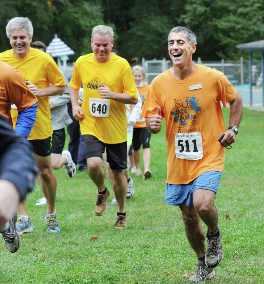 "At right, Bob DeAngelo, executive director of the Boys & Girls Club of Greenwich, competes in the club's ""Muddy Up 4 Kids"" Mud Run at Camp Simmons in Greenwich, Saturday morning, Sept. 29, 2012. Photo: Bob Luckey / Greenwich Time"