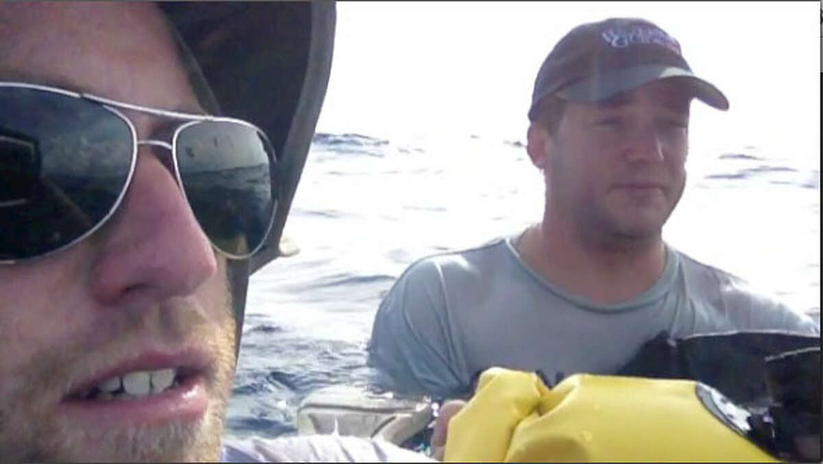 Theodore Wright and Raymond Fosdick float in the Gulf of Mexico Sept 20, 2012 after a crash. The photo is from a video made by Wright's iPad, which was in a waterproof case.