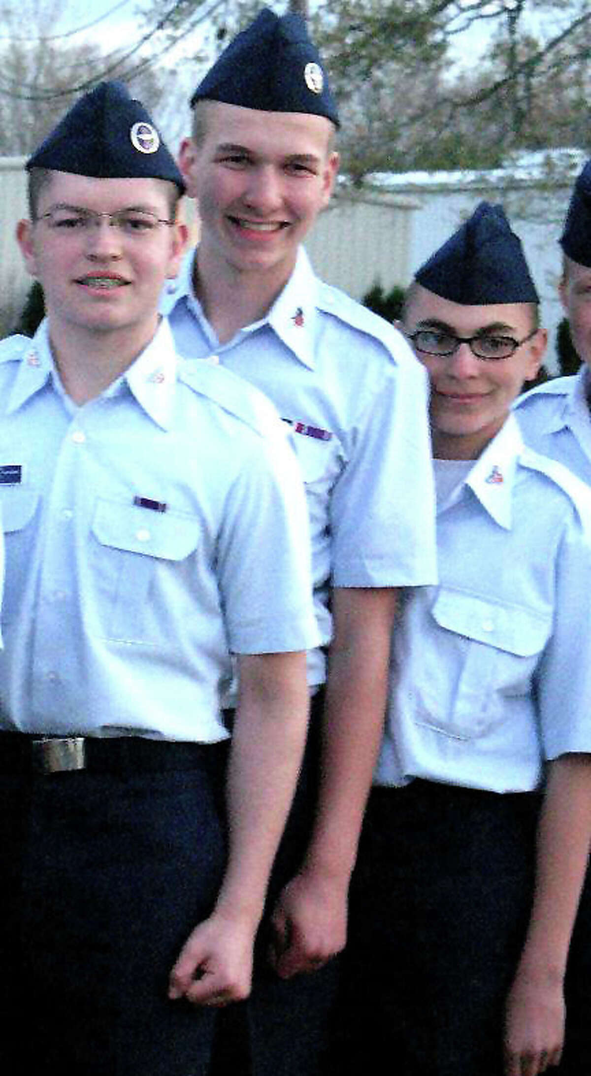Andre Vasquez, left, and Tyler Giuliano, right, are shown in a Civil Air Patrol encampment photo taken April 2012.