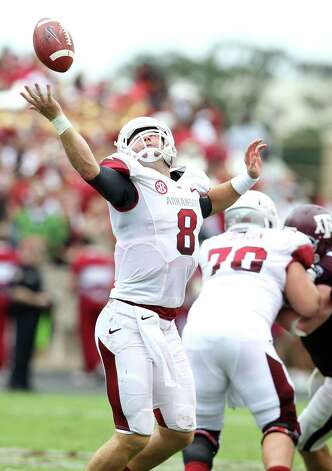 Arkansas quarterback Tyler Wilson (8) tries to get control of a bad snap during the second half of a college football game at Kyle Field, Saturday, Sept. 29, 2012, in College Station. Photo: Karen Warren, Houston Chronicle / © 2012  Houston Chronicle