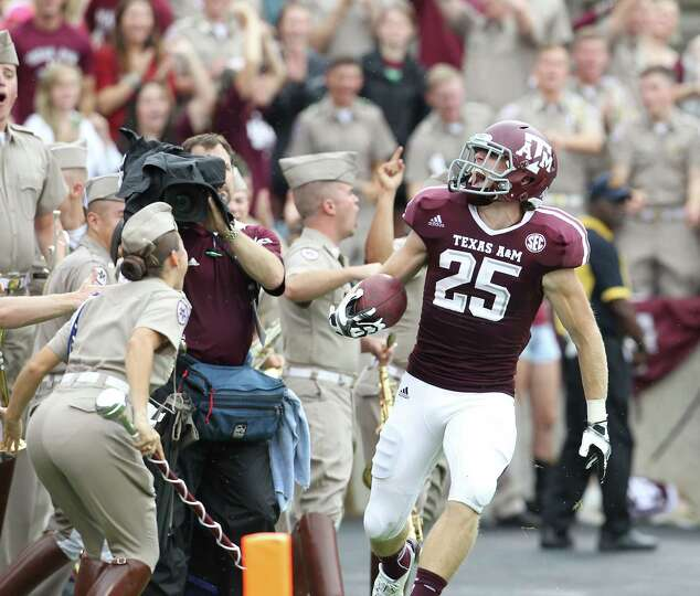 Texas A&M wide receiver Ryan Swope (25) celebrates his 80 yard pass for touchdown during the second